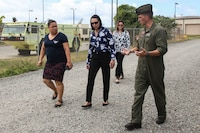 U.S. Marine Corps Maj. Andrew St. George, the assistant operations officer with Marine Aircraft Group 24, led school officials and base staff during a visit to Marine Wing Support Detachment 24, Marine Corps Base Hawaii, June 22, 2018. Paloma Almanza, the principal for Mokapu Elementary School, was provided a guided tour of Marine Corps Air Station Kaneohe Bay to familiarize and welcome her to the base. (U.S. Marine Corps photo by Sgt. Jesus Sepulveda Torres)