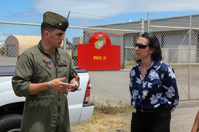 U.S. Marine Corps Maj. Andrew St. George, the assistant operations officer with Marine Aircraft Group 24, answers questions from Paloma Almanza, the principal for Mokapu Elementary School, Marine Corps Base Hawaii, June 22, 2018. Almanza was provided a guided tour of Marine Corps Air Station Kaneohe Bay to familiarize and welcome her to the base. (U.S. Marine Corps photo by Sgt. Jesus Sepulveda Torres)