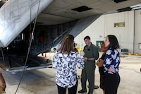 School officials and base staff are given a tour of a CH-53E Super Stallion helicopter at the Marine Heavy Helicopter Squadron 463 hangar, Marine Corps Base Hawaii, by Maj. Andrew St. George, the assistant operations officer with Marine Aircraft Group 24, June 22, 2018. Paloma Almanza, the principal for Mokapu Elementary School, was provided a guided tour of Marine Corps Air Station Kaneohe Bay to familiarize and welcome her to the base. (U.S. Marine Corps photo by Sgt. Jesus Sepulveda Torres)