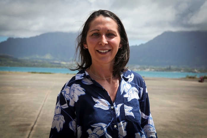 Paloma Almanza, the principal for Mokapu Elementary School, poses for a photo at the Marine Heavy Helicopter Squadron 463 hangar, Marine Corps Base Hawaii, June 22, 2018. Almanza was provided a guided tour of Marine Corps Air Station Kaneohe Bay to familiarize and welcome her to the base. (U.S. Marine Corps photo by Sgt. Jesus Sepulveda Torres)