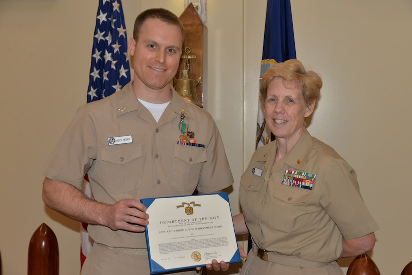 Athens, Ga., native Navy Lt. Matthew Middendorf, left, a physician at Naval Health Clinic Charleston, located at Joint Base Charleston in Goose Creek, S.C., receives a Navy and Marine Corps Achievement Medal from NHCC Executive Officer Capt. Kathleen Hinz during an award ceremony in April. Middendorf was recently named NHCC's Provider of the Year.