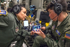 Airmen review procedures for using the vital signs monitor/defibrillator.