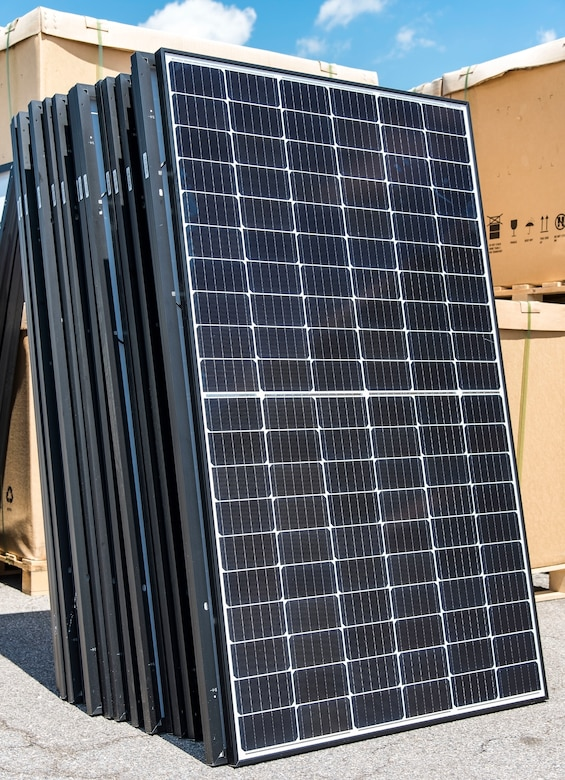 A group of unboxed photovoltaic (PV) panels wait to be taken to a job site in the Dover Family Housing community May 11, 2018, at the Base Theater on Dover Air Force Base, Del. One hundred forty-nine houses in the DFH community are scheduled to have the panels installed on them. (U.S. Air Force photo by Roland Balik)