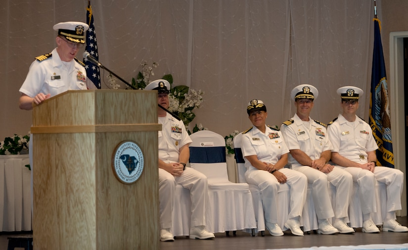 U.S. Navy Capt. Robert Hudson, outgoing deputy commander of Joint Base Charleston and commanding officer of Naval Support Activity Charleston, gives his remarks during a change of command ceremony June 25, 2018, at the Red Bank Club, Joint Base Charleston's Naval Weapons Station.