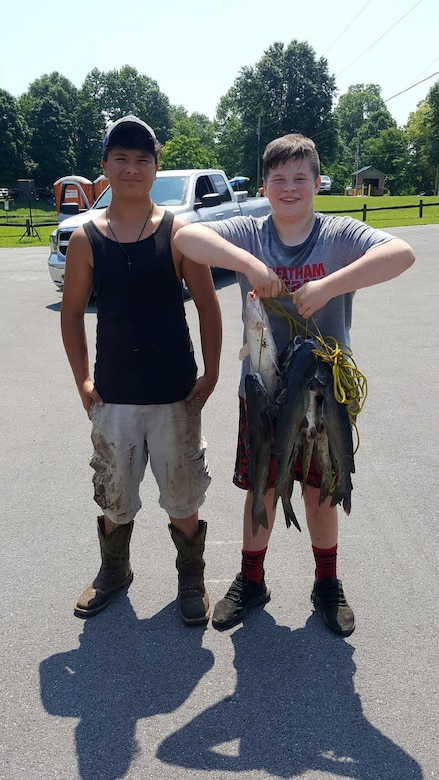 These boys display a string of fish they caught during the Cheatham Lake Annual Fishing Rodeo in Ashland City, Tenn., June 16, 2018.