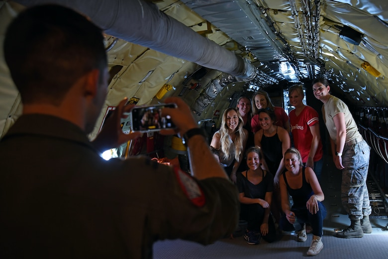 U.S. Airmen assigned to the 20th Fighter Wing (FW) and Team Shaw spouses gather for a photo in a 72nd Air Refueling Squadron KC-135R Stratotanker during an incentive flight over the Atlantic Ocean, June 20, 2018.