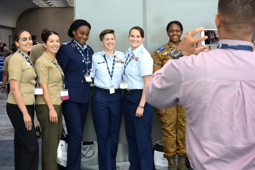 An international group pose for a photo at the 2018 Joint Women's Leadership Symposium June 21, 2018, in San Diego, Calif. The JWLS included attendees from the U.S. Air Force, Army, Navy, Marine Corps, and Coast Guard and 20 other countries. (U.S. Air Force photo by 1st Lt. Annabel Monroe)