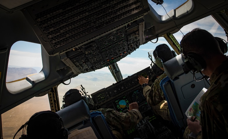 C-17 Globemaster III cargo aircraft pilots perform low-altitude, evasive maneuvers during a training exercise over the Nevada Test and Training Range, June 9, 2018. The pilots performed the exercise to simulate a joint forcible entry exercise. (U.S. Air Force photo by Airman 1st Class Andrew D. Sarver)