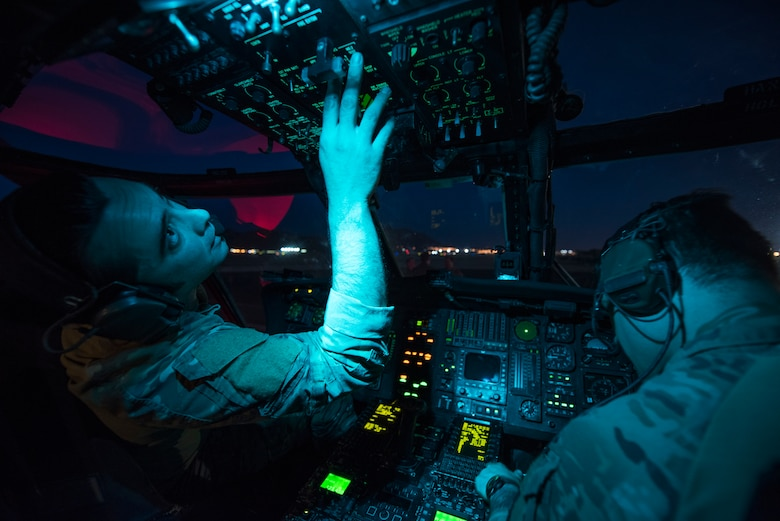 Tech Sgt. Jeremy Sutter, a special missions aviator assigned to the 34th Weapons Squadron, runs avionics checks on an HH-60G Pave Hawk helicopter June 11, 2018 at Nellis Air Force Base, Nev. The crew was preparing for a U.S. Air Force Weapons School training scenario which tasked them with locating, recovering and providing initial medical treatments for a downed pilot. (U.S. Air Force photo by Staff Sgt. Joshua Kleinholz)