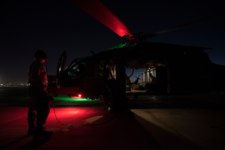 A crew prepares an HH-60G Pave Hawk helicopter prior to a large-scale U.S. Air Force Weapons School Integration Phase training exercise June 11, 2018 at Nellis Air Force Base, Nev. The scenario tested the Pave Hawk crew's ability to work as part of a joint force in order to safely locate, recover, and treat a downed pilot in a contested environment. (U.S. Air Force photo by Staff Sgt. Joshua Kleinholz)