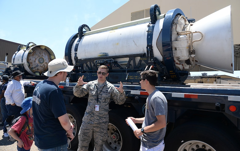 Staff Sgt. Cote Welliver, 581st Missile Maintenance Squadron, answers questions about Minuteman III Intercontinental Ballistic Missile solid fuel rocket motors during the Warriors Over the Wasatch Air and Space Show June 23, 2018, at Hill Air Force Base, Utah. The motors were part of the Ogden Air Logistics Complex's statics on display at the show. (U.S. Air Force photo by Alex R. Lloyd)