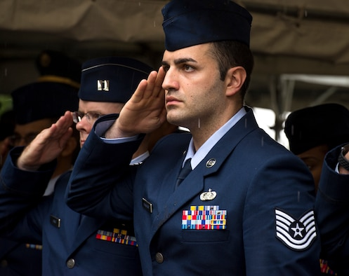 U.S. Air Force Tech. Sgt. Anthony Savary, 730 Air Mobility Squadron communications administrator, salutes during the playing of the National Anthem