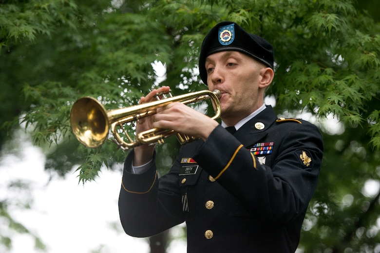 U.S. Army Specialist Thomas Smith, U.S. Army Japan Band member, plays 'Taps'