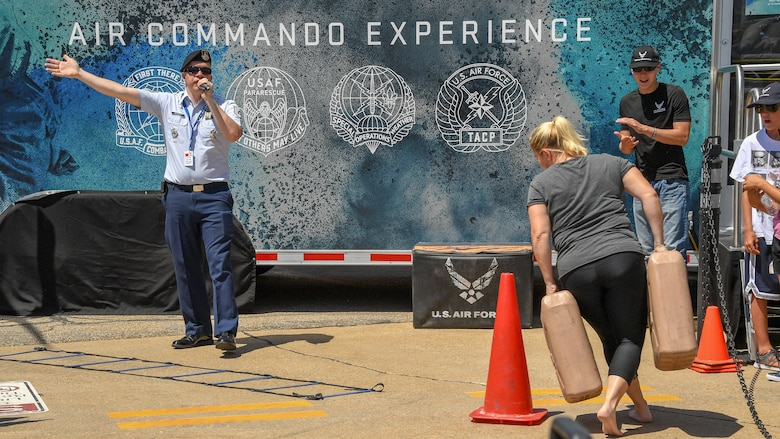 An air show visitor competes in the Air Commando Special Ops skills challenge during the Warriors Over the Wasatch Air and Space Show June 23, 2018, at Hill Air Force Base, Utah. 'The Air Force Special Ops Air Commando Experience' was brought to the air show by the 368th Recruiting Squadron. (U.S. Air Force photo by R. Nial Bradshaw)