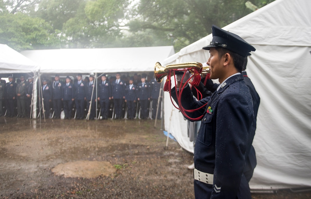 Japanese military officers play the trumpet