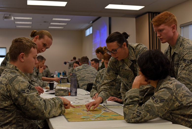 Fairchild Airmen set up a Patient Decontamination Site Tabletop Simulation Activity kit during a Medical Management of Chemical and Biological Casualty course at Fairchild Air Force Base, Washington, June 21, 2018. The tabletop exercise familiarizes personnel with tactics, techniques and procedures associated with planning and executing operations in a Chemical, Biological, Radiological and Nuclear environment. (U.S. Air Force photo/Airman 1st Class Jesenia Landaverde)