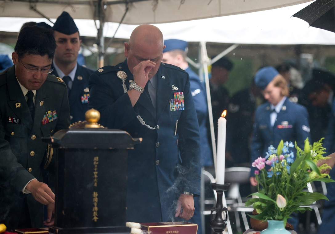 U.S. Air Force Lt. Col. William Villegas, 5th Air Force deputy director, participates in an incense ceremony