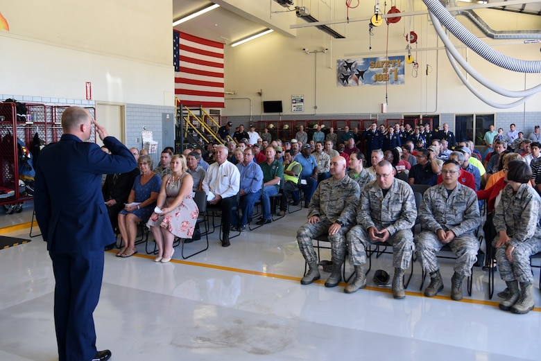 U.S. Air Force Maj. Nicholas Anderson, 17th Civil Engineer Squadron commander, salutes his squadron for the first time during the 17th CES Assumption of Command at the fire department on Goodfellow Air Force Base, Texas, June 22, 2018. The assumption of command ceremony provides an opportunity for members of the unit to see their new commander, and for the new commander to inspect his or her troops. (U.S. Air Force photo by Staff Sgt. Joshua Edwards/Released)