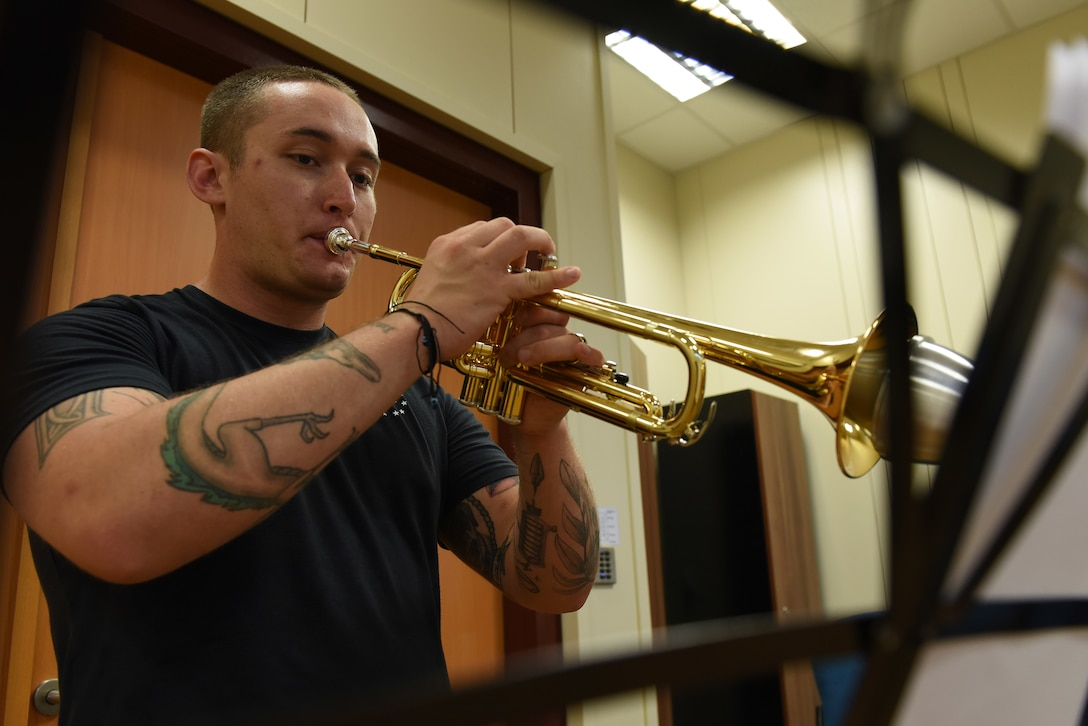 U.S. Air Force Staff Sgt. Matthew Andrews, 39th Force Support Squadron NCO in charge of the Community Center, practices playing his trumpet in the Community Center at Incirlik Air Base, Turkey, June 18, 2018.