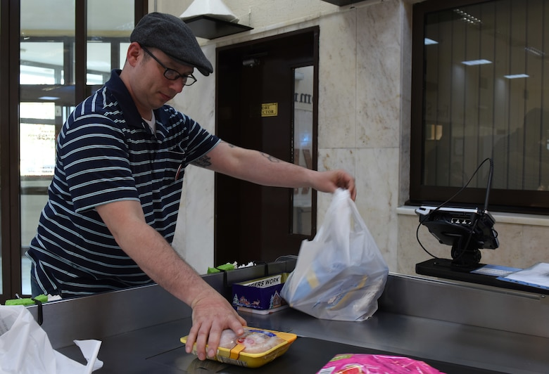 U.S. Air Force Master Sgt. Travis Lacy, 39th Force Support Squadron superintendent of manpower, organization and continuous process improvement, bags groceries at the Commissary at Incirlik Air Base, Turkey, June 19, 2018.