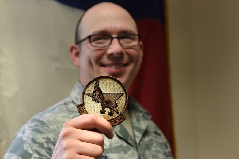 U.S. Air Force Master Sgt. Travis Lacy, 39th Force Support Squadron superintendent of manpower, organization and continuous process improvement, holds a 22nd Expeditionary Air Refueling Squadron patch at Incirlik Air Base, Turkey, June 19, 2018.