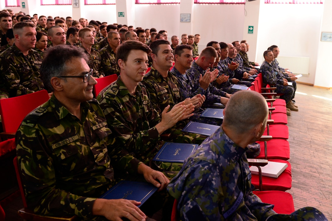 Romanian students celebrate after graduating from the first-ever senior noncommissioned officer mobile education course June 8 to 22, 2018, at Boboc Air Base, in Buzău, Romania. The SNCOA mobile training team partnered with the Inter-European Air Forces Academy to provide a two-week course, condensed from the full five-week course held at Maxwell Air Force Base- Gunter Annex, Alabama. (U.S. Air Force photo by Tech. Sgt. Staci Kasischke)