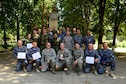U.S. Air Force Senior Noncommissioned Officer Academy instructors pose with Romanian Air Force students after the first-ever senior noncommissioned officer mobile education course graduation June 8 to 22, 2018, at Boboc Air Base, in Buzău, Romania. The SNCOA mobile training team partnered with the Inter-European Air Forces Academy to provide a two-week course, condensed from the full five-week course held at Maxwell Air Force Base- Gunter Annex, Alabama. (U.S. Air Force photo by Tech. Sgt. Staci Kasischke)