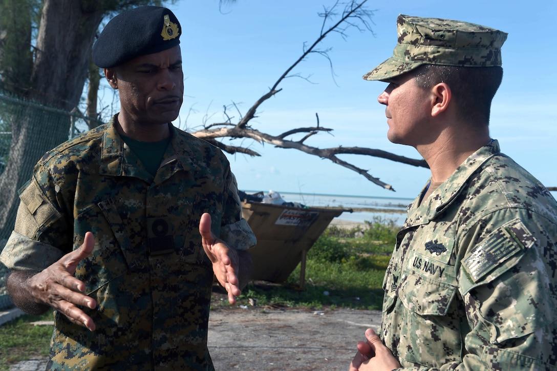 Military troops talk.