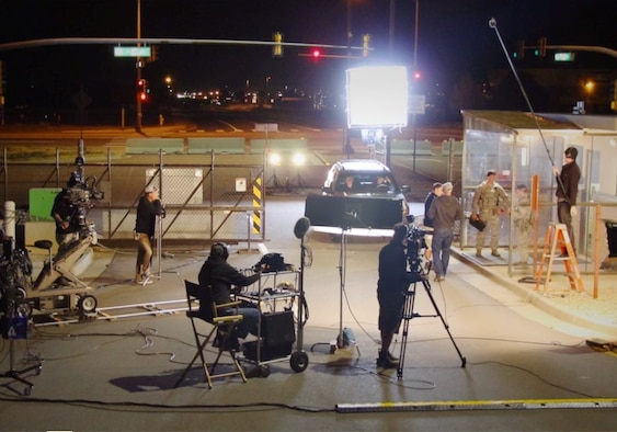 A film crew shoots a nighttime scene at Buckley Air Force Base, Colo., Sept. 24, 2015. Members of the Center of Excellence for Medical Multimedia regularly work with film production professionals to create training and education videos for the Department of Defense. (Courtesy photo)