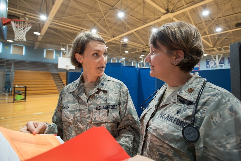 U.S. Air Force Lt. Col. Patricia Adams (left), an optometrist from the Kentucky Air National Guard's 123rd Airlift Wing, discusses patient care with U.S. Air Force Maj. Tiffany Hubbard, a nurse practitioner, at a health-care clinic being run by the Air Guard and U.S. Navy Reserve at Lee County High School in Beattyville, Ky., June 20, 2018. The Beattyville clinic is one of four that comprised Operation Bobcat, a 10-day mission to provide military medical troops with crucial training in field operations and logistics while offering no-cost health care to the residents of Eastern Kentucky. The clinics, which operated from June 15-24, offered non-emergent medical care; sports physicals; dental cleanings, fillings and extractions; eye exams and no-cost prescription eye glasses. (U.S. Air National Guard photo by Lt. Col. Dale Greer)