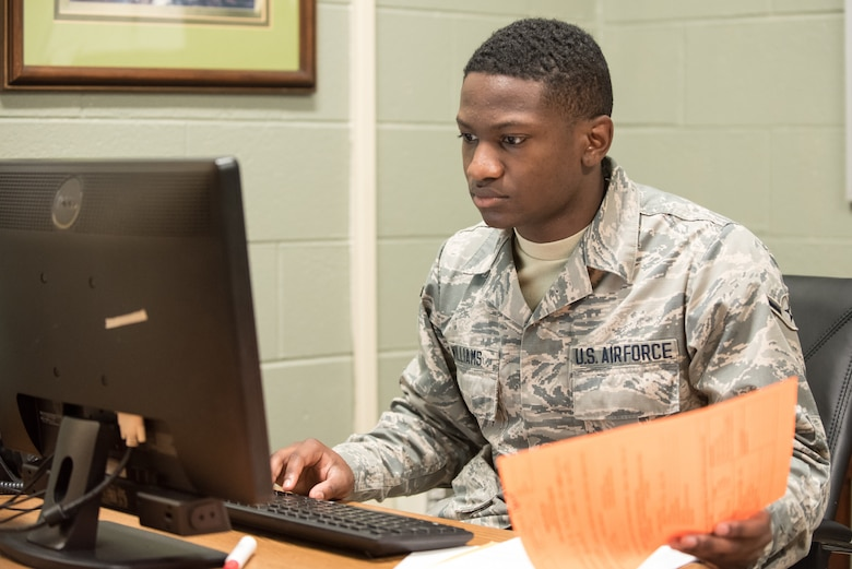 U.S. Air Force Airman Johan Williams, a medical administration specialist with the Kentucky Air National Guard's 123rd Airlift Wing, inputs patient-care data at a health-care clinic being operated by the Air Guard and U.S. Navy Reserve at Breathitt County High School in Jackson, Ky., June 20, 2018. The Jackson clinic is one of four that comprised Operation Bobcat, a 10-day mission to provide military medical troops with crucial training in field operations and logistics while offering no-cost health care to the residents of Eastern Kentucky. The clinics, which operated from June 15-24, offered non-emergent medical care; sports physicals; dental cleanings, fillings and extractions; eye exams and no-cost prescription eye glasses. (U.S. Air National Guard photo by Lt. Col. Dale Greer)