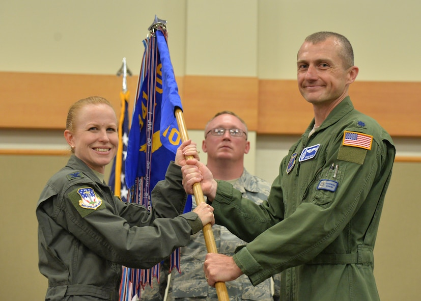 Lt. Col. Kevin Byrd, right, accepts command of the 10th Missile Squadron from Col. Anita Feugate Opperman, 341st Operations Group commander during a change of command ceremony June 21, 2018, at the Grizzly Bend on Malmstrom AFB, Mont.