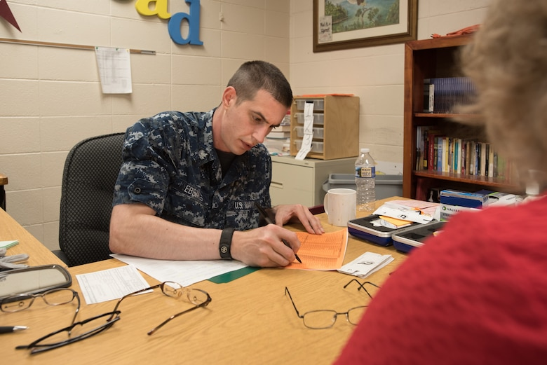 U.S. Navy HM3 Troy Ebbings, a corpsman from Expeditionary Medical Facility Great Lakes in Illinois, fills out an order for eyeglasses at a health-care clinic at Owsley County High School in Booneville, Ky., June 24, 2018. The clinic is one of four that comprised Operation Bobcat, a 10-day mission to provide military medical troops with crucial training in field operations and logistics while offering no-cost health care to the residents of Eastern Kentucky. The clinics, which operated from June 15-24, offered non-emergent medical care; sports physicals; dental cleanings, fillings and extractions; eye exams and no-cost prescription eye glasses. (U.S. Air National Guard photo by Lt. Col. Dale Greer)