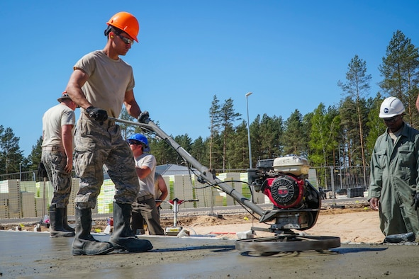 Airmen from the 134th Civil Engineering Squadron construct concrete pads during their annual deployment for training May 4-19 at Camp Adazi, Latvia.