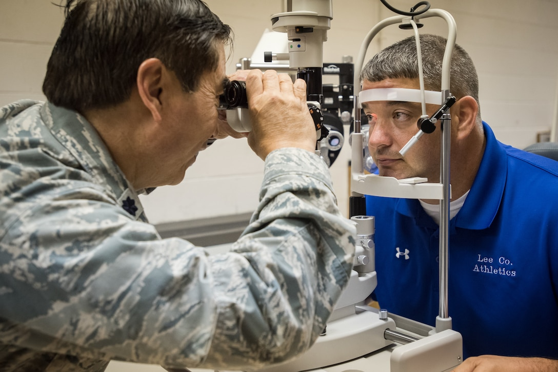 U.S. Air Force Lt. Col. Ronald Short, an optometrist from the California Air National Guard's 163rd Attack Wing, conducts an eye exam on a local resident at a no-cost health-care clinic at Lee County High School in Beattyville, Ky., June 15, 2018. The clinic is one of four that was staffed by military health-care professionals in Eastern Kentucky from June 15 to June 24 as part of an Innovative Readiness Training mission called Operation Bobcat. The mission provided military forces with crucial expeditionary training while offering no-cost medical, dental and optometry care to area residents. (U.S. Air National Guard photo by Lt. Col. Dale Greer)