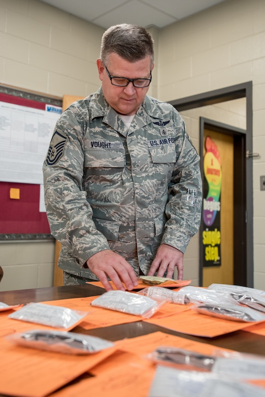 U.S. Air Force Master Sgt. Paul Vought, a medic from the Kentucky Air National Guard's 123rd Airlift Wing, sorts patient eyeglasses at a health-care clinic being operated by the Air Guard and U.S. Navy Reserve at Breatthitt County High School in Jacosn, Ky., June 20, 2018. The clinic is one of four that comprised Operation Bobcat, a 10-day mission to provide military medical troops with crucial training in field operations and logistics while offering no-cost health care to the residents of Eastern Kentucky. The clinics, which operated from June 15-24, offer non-emergent medical care; sports physicals; dental cleanings, fillings and extractions; eye exams and no-cost prescription eye glasses. (U.S. Air National Guard photo by Lt. Col. Dale Greer)