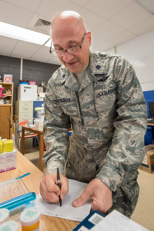 U.S. Air Force Lt. Col. Philip Forlenza, a pharmacist from the New York Air National Guard's 105th Airlift Wing, fills a patient prescription at a health-care clinic being operated by the Air Guard and U.S. Navy Reserve at Breathitt County High School in Jackson, Ky., June 20, 2018. The Jackson clinic is one of four that comprised Operation Bobcat, a 10-day mission to provide military medical troops with crucial training in field operations and logistics while offering no-cost health care to the residents of Eastern Kentucky. The clinics, which operated from June 15-24, offered non-emergent medical care; sports physicals; dental cleanings, fillings and extractions; eye exams and no-cost prescription eye glasses. (U.S. Air National Guard photo by Lt. Col. Dale Greer)