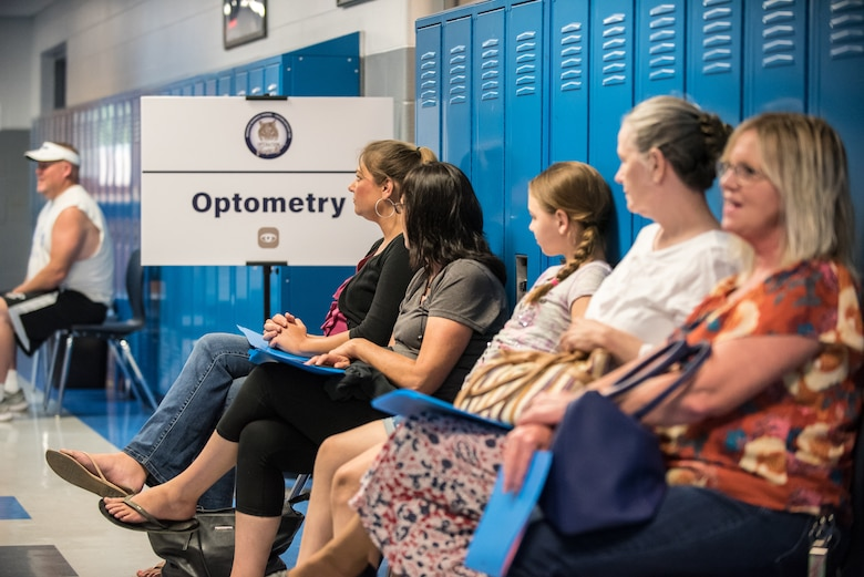 Area residents wait for optometry exams at a health-care clinic being operated by the Air National Guard and U.S. Navy Reserve at Estill County High School in Irvin, Ky., June 21, 2018. The clinic is one of four that comprised Operation Bobcat, a 10-day mission to provide military medical troops with crucial training in field operations and logistics while offering no-cost health care to the residents of Eastern Kentucky. The clinics, which operated from June 15-24, offered non-emergent medical care; sports physicals; dental cleanings, fillings and extractions; eye exams and no-cost prescription eye glasses. (U.S. Air National Guard photo by Lt. Col. Dale Greer)