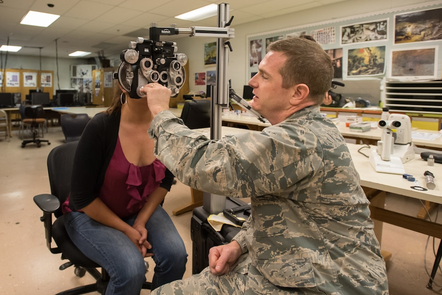 U.S. Air Force Maj. Robert Groves, an optometrist from the New Hampshire Air National Guard's 157th Air Refueling Wing, conducts a vision exam at a health-care clinic being operated by the Air Guard and U.S. Navy Reserve at Estill County High School in Irvine, Ky., June 21, 2018. The clinic is one of four that comprised Operation Bobcat, a 10-day mission to provide military medical troops with crucial training in field operations and logistics while offering no-cost health care to the residents of Eastern Kentucky. The clinics, which operated from June 15-24, offered non-emergent medical care; sports physicals; dental cleanings, fillings and extractions; eye exams and no-cost prescription eye glasses. (U.S. Air National Guard photo by Lt. Col. Dale Greer)