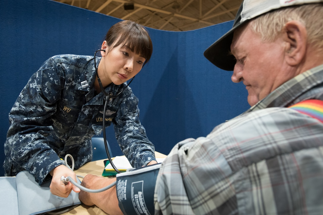 U.S. Navy Lt. Xin Wu, a nurse from Expeditionary Medical Facility Bethesda in Maryland, takes the blood pressure of a patient at a health-care clinic being operated by the Air Guard and U.S. Navy Reserve at Lee County High School in Beattyville, Ky., June 21, 2018. The clinic is one of four that comprised Operation Bobcat, a 10-day mission to provide military medical troops with crucial training in field operations and logistics while offering no-cost health care to the residents of Eastern Kentucky. The clinics, which operated from June 15-24, offered non-emergent medical care; sports physicals; dental cleanings, fillings and extractions; eye exams and no-cost prescription eye glasses. (U.S. Air National Guard photo by Lt. Col. Dale Greer)