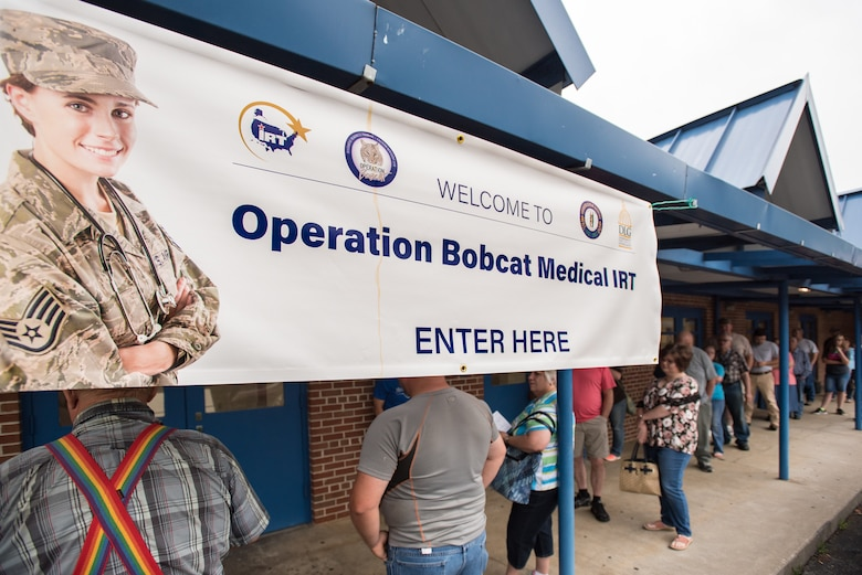 Area residents line up outside Lee County High School in Beattyville, Ky., June 21, 2018, to receive treatment at a health-care clinic being operated by the Air National Guard and U.S. Navy Reserve June 20, 2018. The clinic is one of four that comprised Operation Bobcat, a 10-day mission to provide military medical troops with crucial training in field operations and logistics while offering no-cost health care to the residents of Eastern Kentucky. The clinics, which operated from June 15-24, offered non-emergent medical care; sports physicals; dental cleanings, fillings and extractions; eye exams and no-cost prescription eye glasses. (U.S. Air National Guard photo by Lt. Col. Dale Greer)