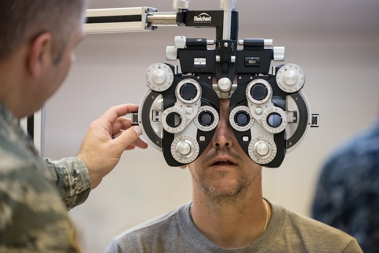 U.S. Air Force Maj. Brett Ringger, an optometrist from the Texas Air National Guard's 136th Airlift Wing, tests a patient's vision at a health-care clinic being operated by the Air National Guard and U.S. Navy Reserve at Lee County High School in Beattyville, Ky., June 23, 2018. The clinic is one of four that comprised Operation Bobcat, a 10-day mission to provide military medical troops with crucial training in field operations and logistics while offering no-cost health care to the residents of Eastern Kentucky. The clinics, which operated from June 15-24, offered non-emergent medical care; sports physicals; dental cleanings, fillings and extractions; eye exams and no-cost prescription eye glasses. (U.S. Air National Guard photo by Lt. Col. Dale Greer)