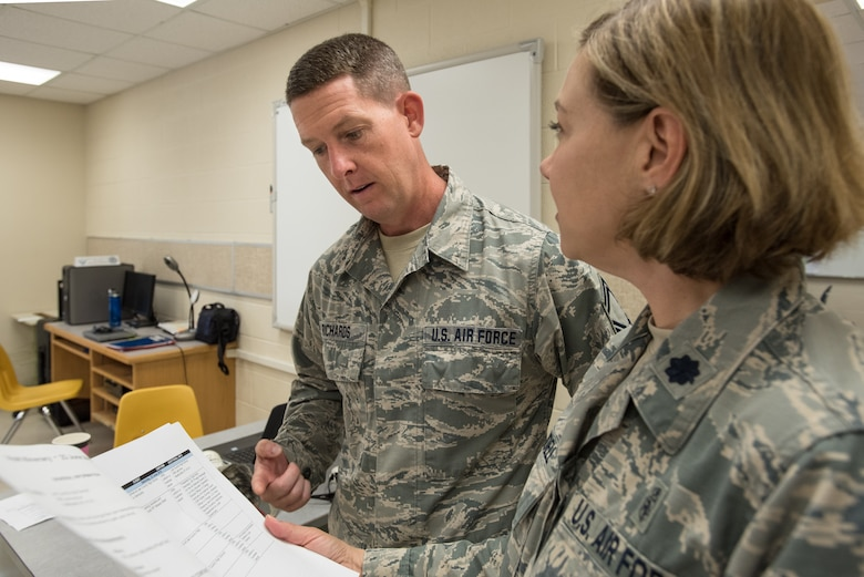 U.S. Air Force Senior Master Sgt. Kenneth Richards (left), superintendent for the Kentucky Air National Guard's 123rd Medical Group, and U.S. Air Force Lt. Col. Amy Mundell, a medical administrative officer with the same unit, discuss plans for Distinguished Visitor Day at a health-care clinic at Lee County High School in Beattyville, Ky., June 24, 2018. The clinic is one of four that comprised Operation Bobcat, a 10-day mission to provide military medical troops with crucial training in field operations and logistics while offering no-cost health care to the residents of Eastern Kentucky. The clinics, which operated from June 15-24, offered non-emergent medical care; sports physicals; dental cleanings, fillings and extractions; eye exams and no-cost prescription eye glasses. (U.S. Air National Guard photo by Lt. Col. Dale Greer)