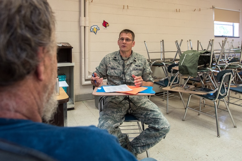 U.S. Air Force Lt. Col. Darin Jacoby, a flight surgeon from the Kentucky Air National Guard's 123rd Airlift Wing, talks with a patient about his medical history at a health-care clinic at Lee County High School in Beattyville, Ky., June 24, 2018. The clinic is one of four that comprised Operation Bobcat, a 10-day mission to provide military medical troops with crucial training in field operations and logistics while offering no-cost health care to the residents of Eastern Kentucky. The clinics, which operated from June 15-24, offered non-emergent medical care; sports physicals; dental cleanings, fillings and extractions; eye exams and no-cost prescription eye glasses. (U.S. Air National Guard photo by Lt. Col. Dale Greer)