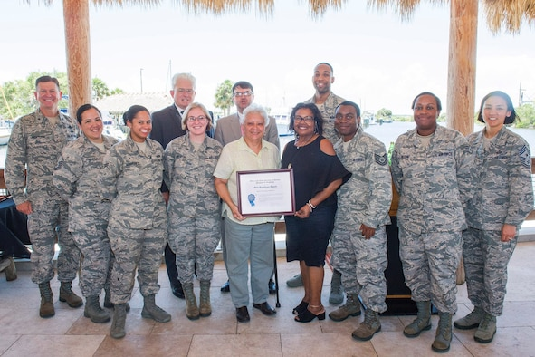 Members from the 45th Force Support Squadron pose for a photo May 17, 2018, with the Site Excellance Award at Patrick Air Force Base, Fla. The award was presented to FSS by Brig. Gen. Wayne Monteith, commander of the 45th Space Wing, for exceptional service and support of DEERS and RAPIDS. (U.S. Air Force photo by Phil Sunkel)