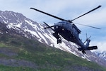 A 210th Rescue Squadron HH-60G Pave Hawk conducts hoist training June 5, 2018, at Eklutna Glacier during a fini flight for Chief Master Sgt. Lance Jordan, command chief master sergeant for the Alaska Air National Guard. A similar helo was involved in the weekend rescue of a critically injured climber.