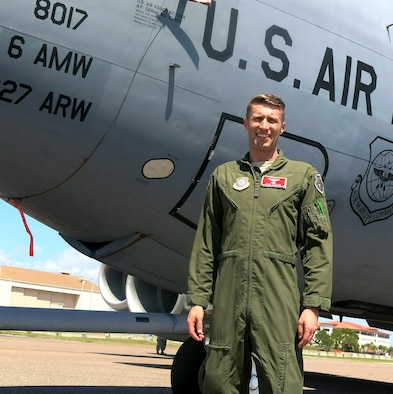 U.S Air Force Maj. Ryan Garlow, 6th Aircraft Maintenance Squadron commander, poses in front of a KC-135 Stratotanker aircraft before Tampa Bay AirFest 2016 at MacDill Air Force Base, Fla. March 18, 2016.