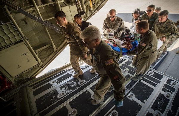 Members of the Acute Lung Resuce Team from the 59th Medical Wing, Joint Base San Antonio-Lackland, Texas, and the Wyoming Air National Guard load a patient onto a C-130J Super Hercules for medical evacuation at Fort Bliss, Texas, June, 10, 2018. The ALRT is the Department of Defense's only medical evacuation team with Extra Corporeal Membrane Oxygenation capabilities. ECMO enables the team to safely transer critically ill patients with severe heart and lung issues across long distances for further treatment.