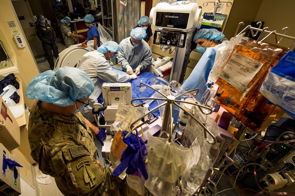 Members of the Acute Lung Resuce Team from the 59th Medical Wing, Joint Base San Antonio-Lackland, Texas, perform an Extra Corporeal Membrane Oxygenation procedure on a patient in El Paso, Texas, June, 10, 2018. The team is the Department of Defense's only medical evacuation team with ECMO capabilities. ECMO enables the team to safely transfer critically ill patients with severe heart and lung issues across long distances for further treatment.