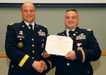 Army Maj. Gen. David G. Bassett congratulates Army Lt. Col. Paul V. McCullough III during his retirement ceremony June 21. McCullough retired with 20 years of military service.